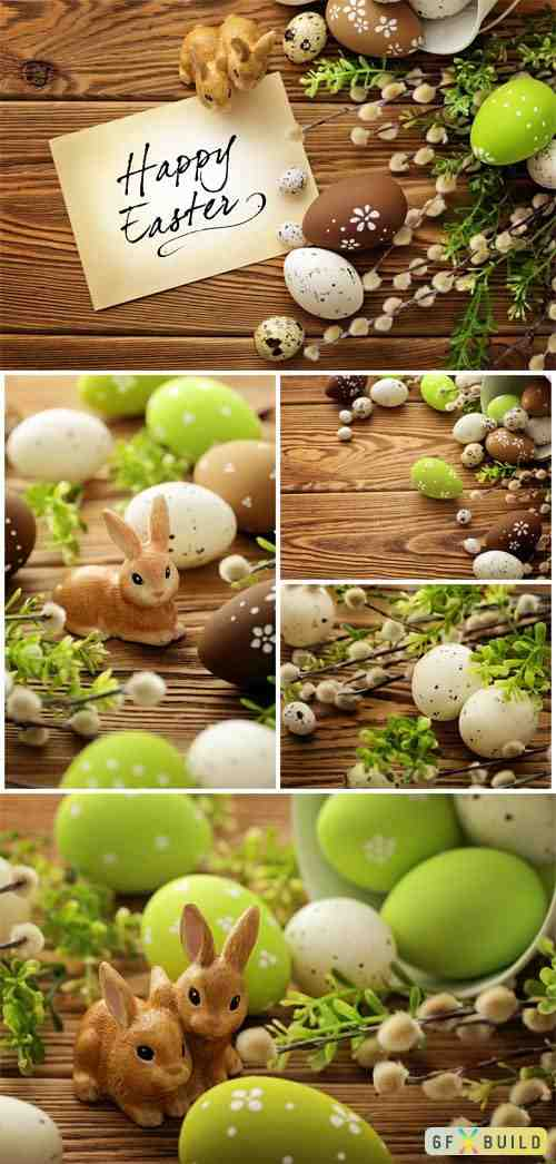 Easter bunnies and vine branches on wood background stock photo
