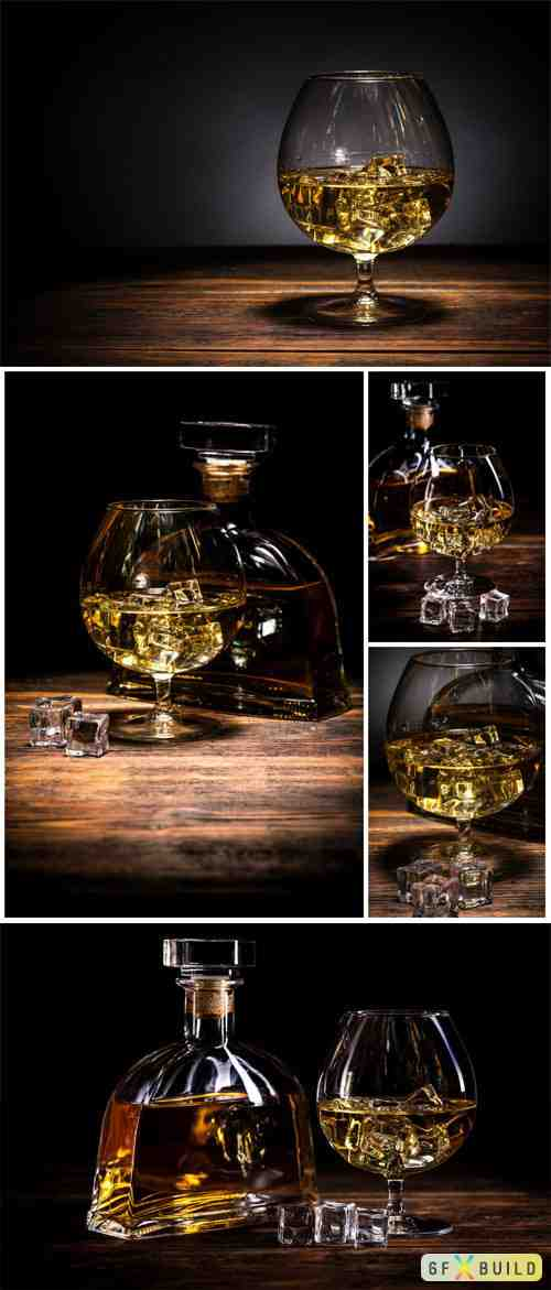 Bottle and glass with cognac, alcoholic drink stock photo