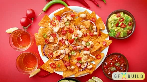 A Plate of Delicious Tortilla Nachos with Melted Cheese Sauce Grilled Chicken
